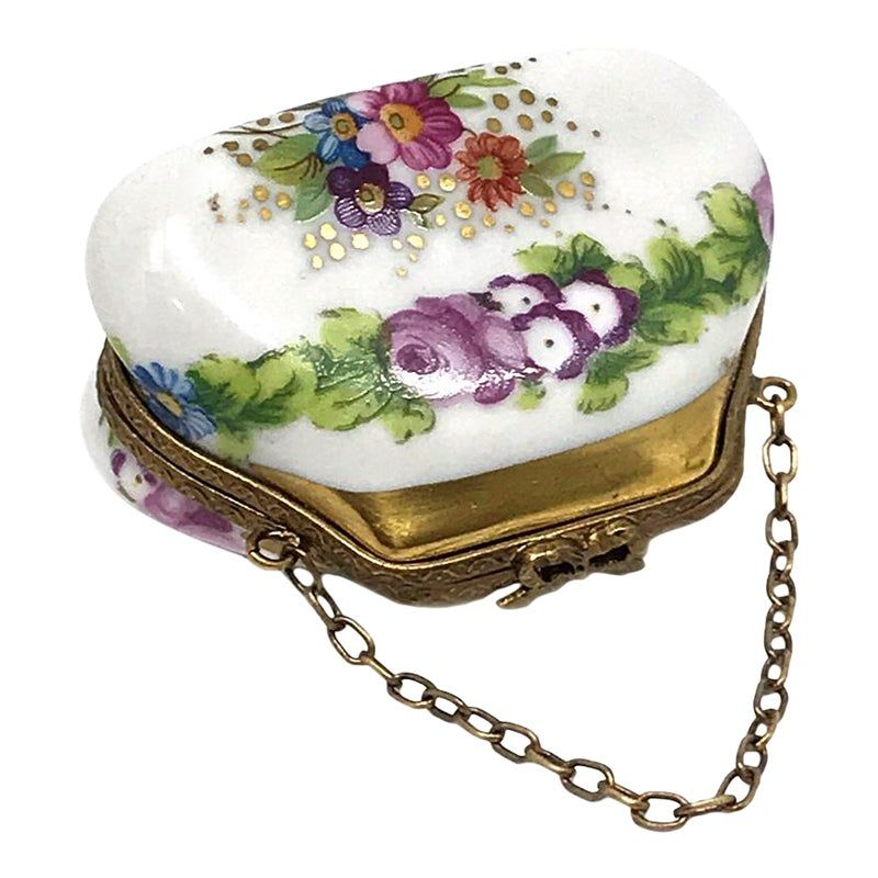 A screen painted small purse Limoges porcelain box. There are more flowers inside of box.