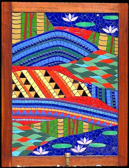 Brightly coloured mural representing the Australian lanscape through the eyes of a King Parrot. King Parrot Dreaming mosaic mural in ceramic tiles by Brett Campbell Mosaics