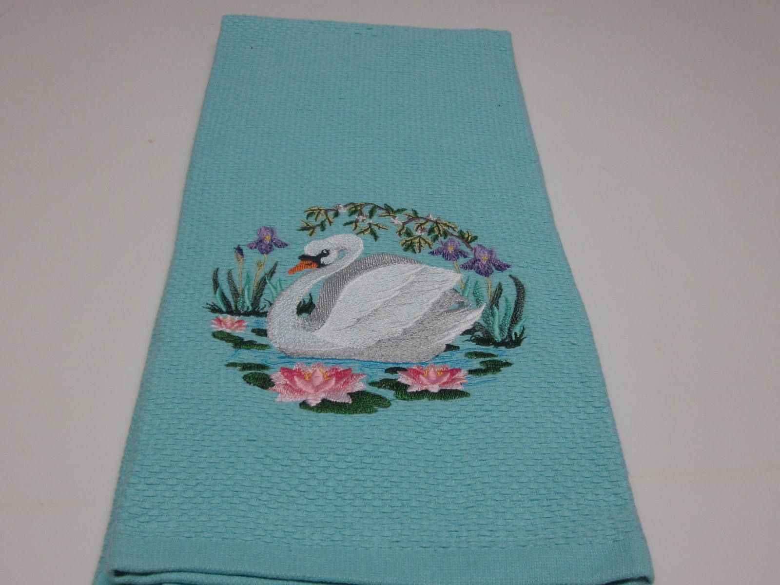 Beautiful swan embroidered on large, plush pique front, terry backed ...