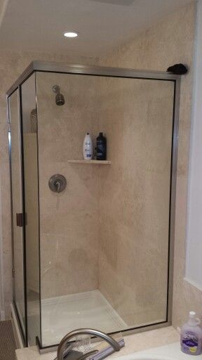 Travertine Shower With A Corner Shelf. Installed By BPu0027s Tile