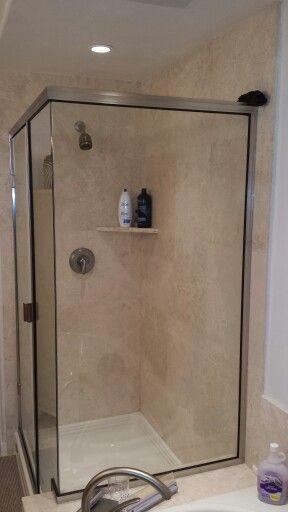 Travertine Shower With A Corner Shelf. Installed By BPu0027s Tile