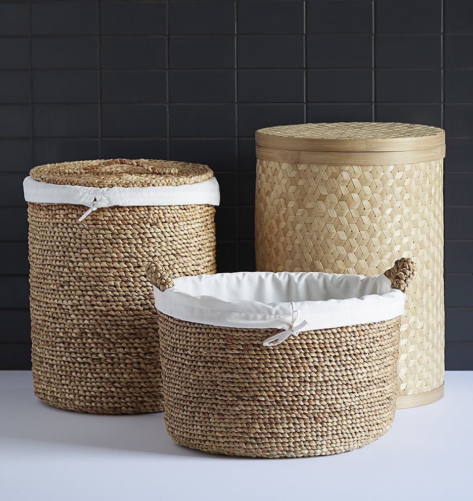 Versatile and classic in design, our Woven Water Hyacinth Basket adds beauty and texture while helping to keep clutter at bay. This sweet and simple basket features a removable cotton liner with drawstring - making it perfect for laundry, toys, or whatever your life has in store.  * Water hyacinth basket, cotton liner * Imported