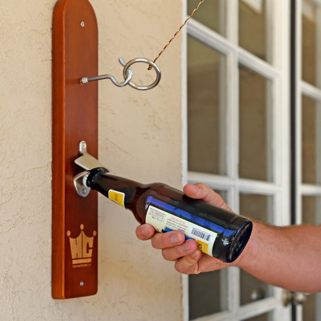 Hook and ring game with bottle opener and bottle