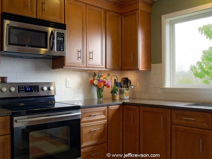 black quartz countertops white subway tile backsplash ... on Maple Cabinets With Black Countertops  id=73272