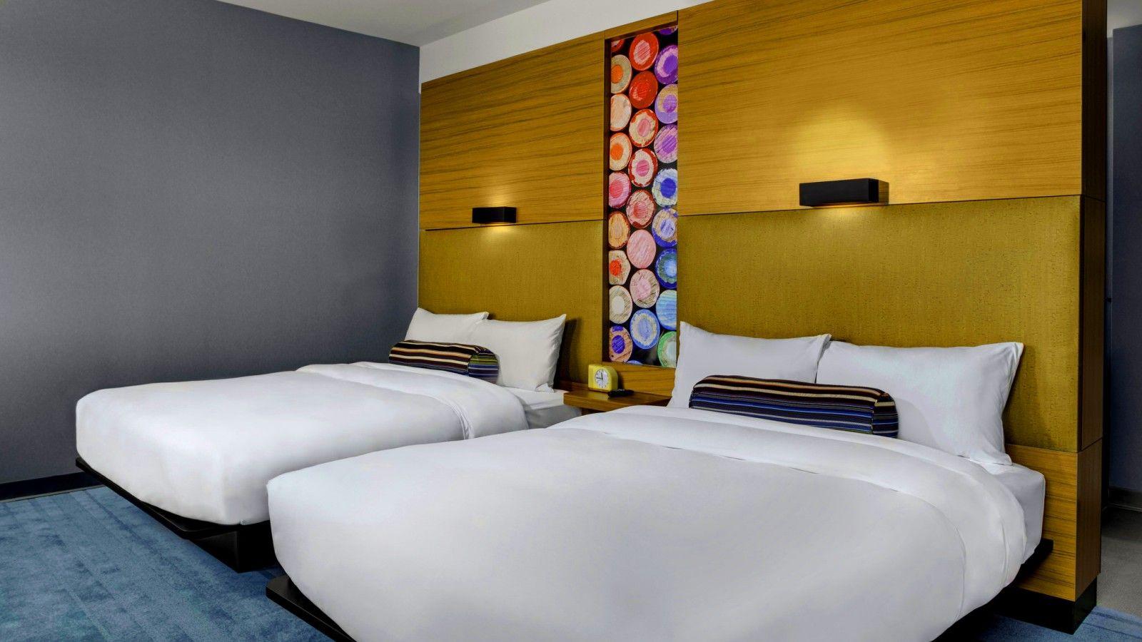 aloft double queen guest room luxury hotel travel austin texas