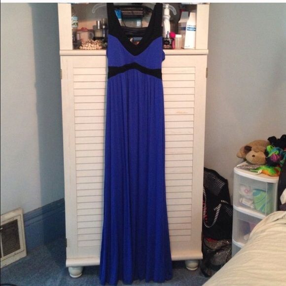 Bebe Gorgeous blue and black open back maxi! This dress is really gorgeous and so comfy! It's a soft cotton material with stunning open back! I only got to wear it once and I'm losing weight so it doesn't fit :( perfect for a curvy girl and it is long so if you're short you may need to hem it. Brand is 2b Bebe. Fits size 14-16 best. bebe Dresses