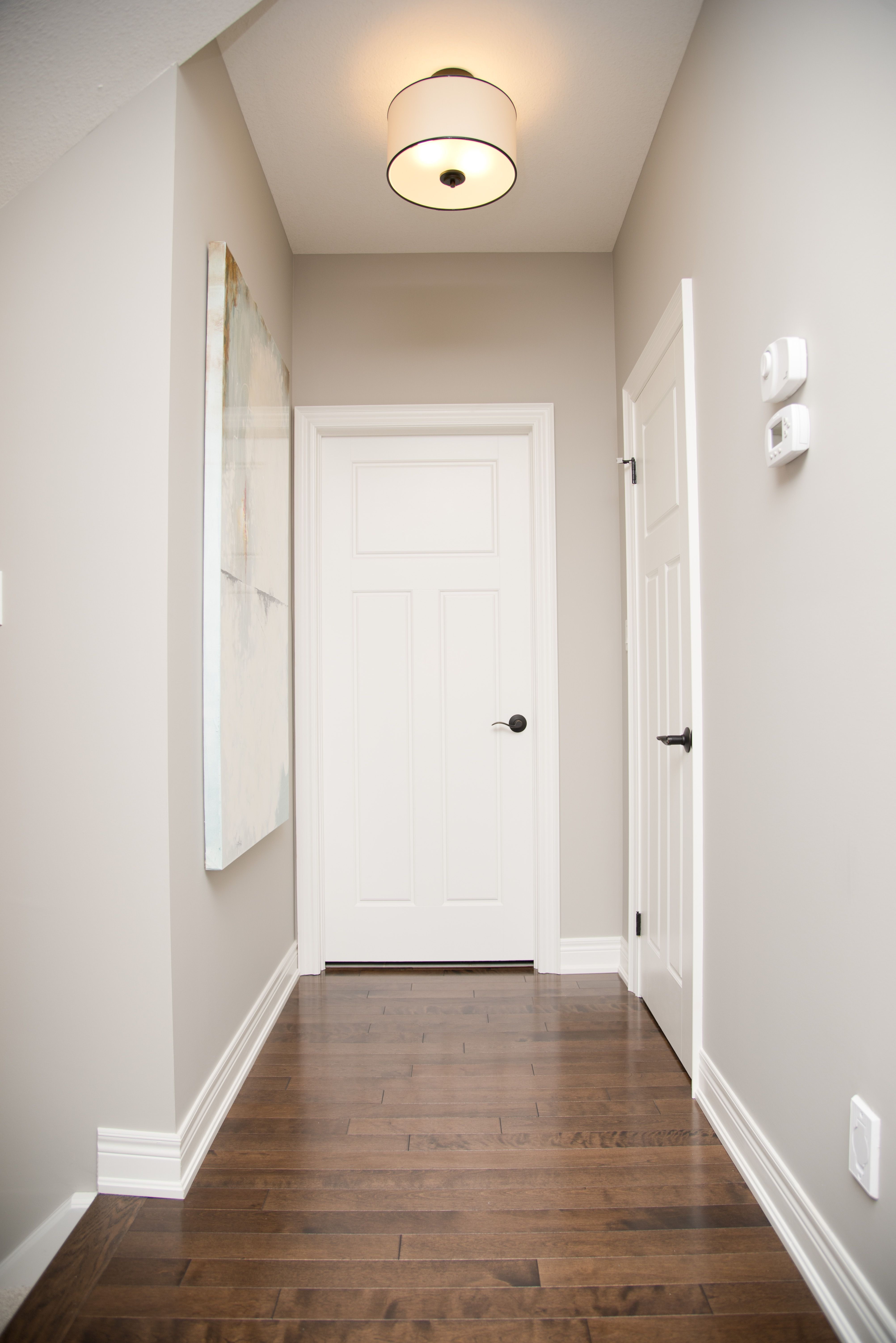 A neutral wall colour paired with bright white trim