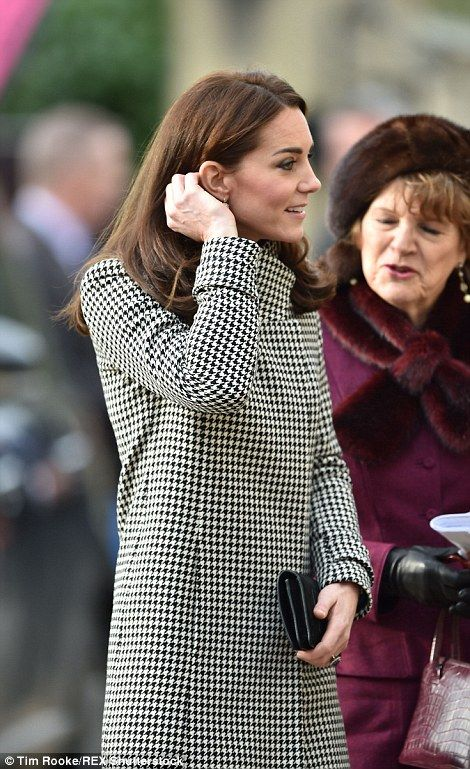 The Duchess of Cambridge, dressed in a chic black and white coat, arrives for a visit to the charity's Centre for Addiction Treatment Studies in Warminster