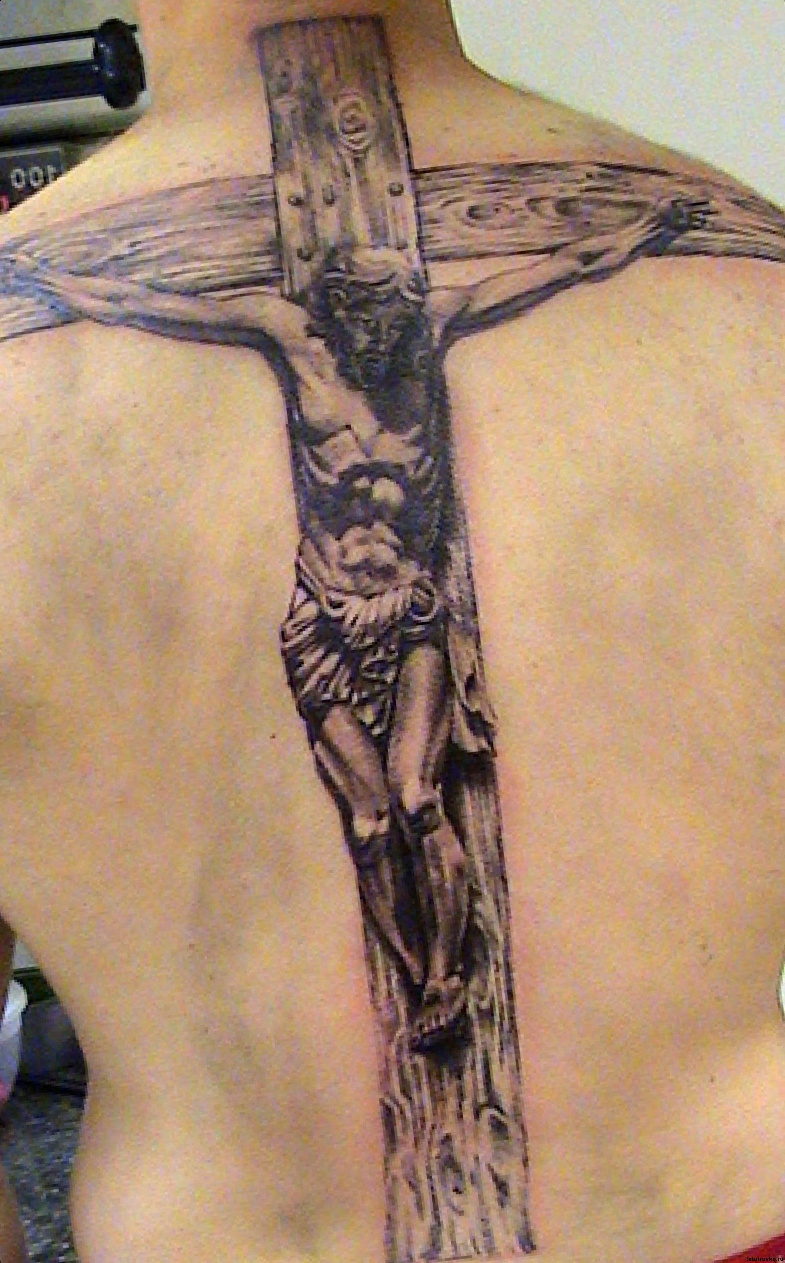 Cross on the jesus tattoo