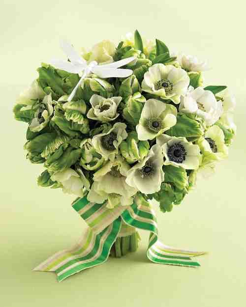 Stems of the feathery, crepe-like blooms add tons of texture to this green-and-white delight. Bunched together en masse and tied together with a crisp, multihued striped ribbon, the vibrant bouquet is more like a portable garden -- cheerfully, blissfully uplifting. A sleek white dragonfly (we painted it white) perches atop verdant masses of green and white, giving this bouquet a fresh, summer-day feel. Dragonfly from Floraltrims. Two-inch cotton-striped ribbon (#2101, color #277) from Hyman…