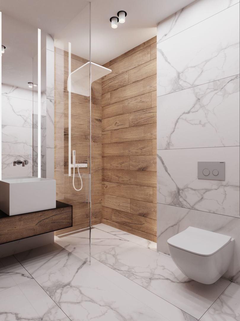 baño con ducha forrada en porcelánico imitación mármol y ...