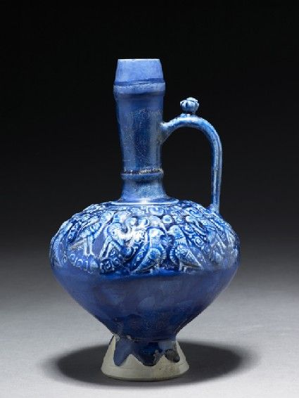 Jug with human-headed birds paired in roundels Iran, 2nd half of the 12th century - early 13th century Great Seljuq Period (1040 - 1194) fritware, with moulded decoration under a blue glaze