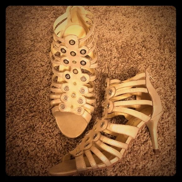 Brand new strapped sandals Cute cream colored strapped heels. They are shimmery Shoes Sandals
