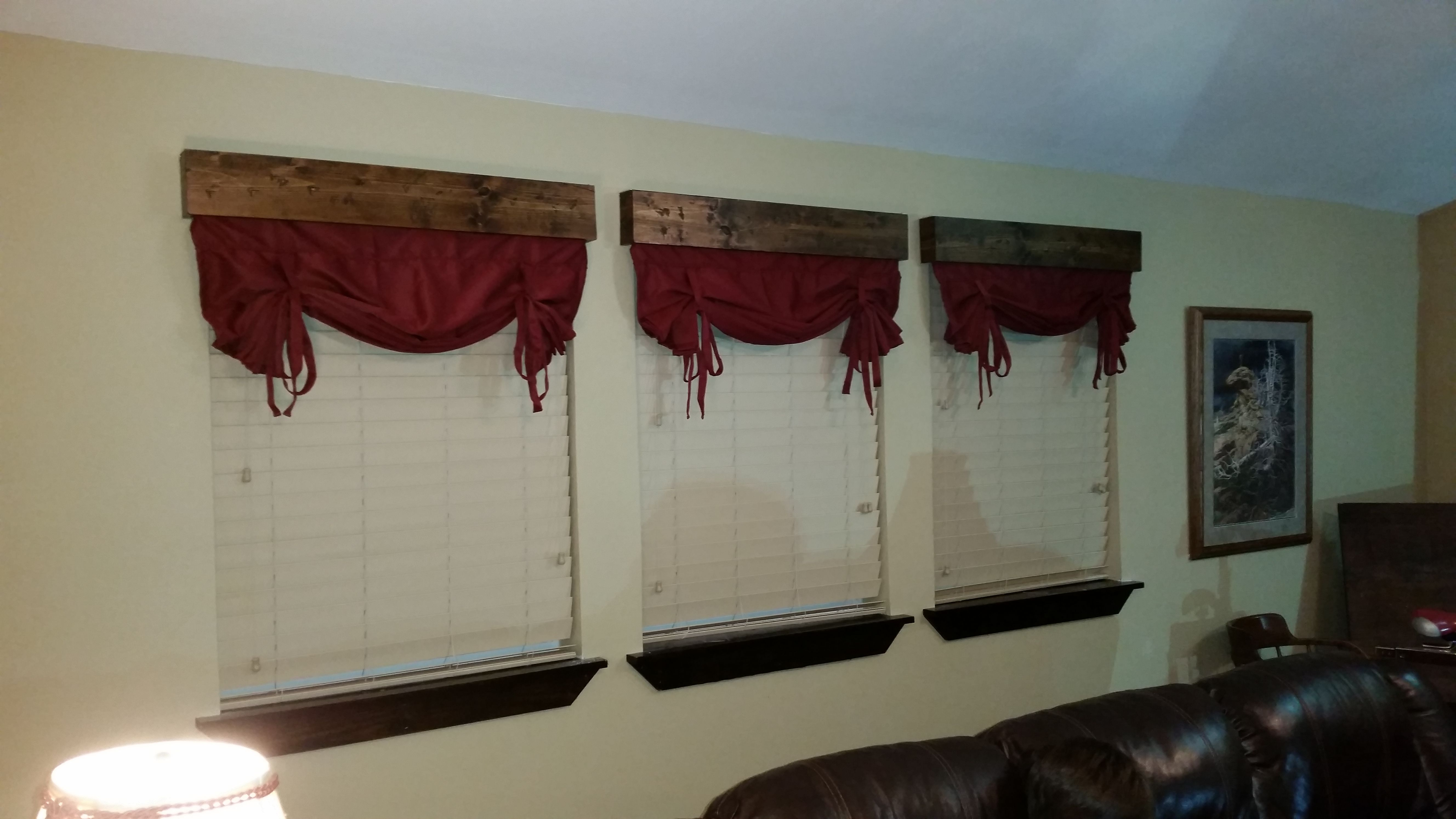wooden valences with drop curtains stapled to the back.  Quick and easy.