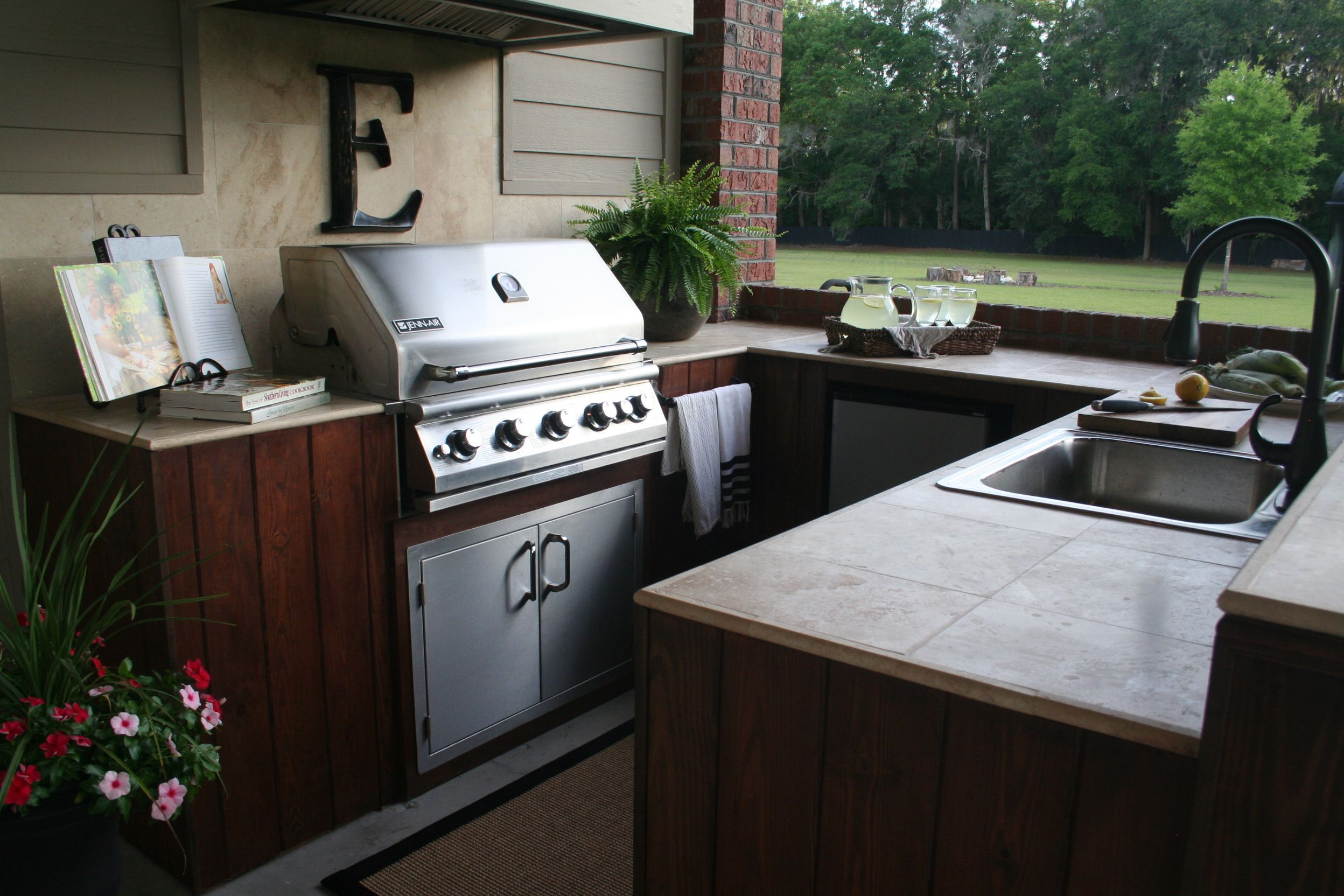 summer kitchen with jenn-air grill, travertine tops and outdoor hood