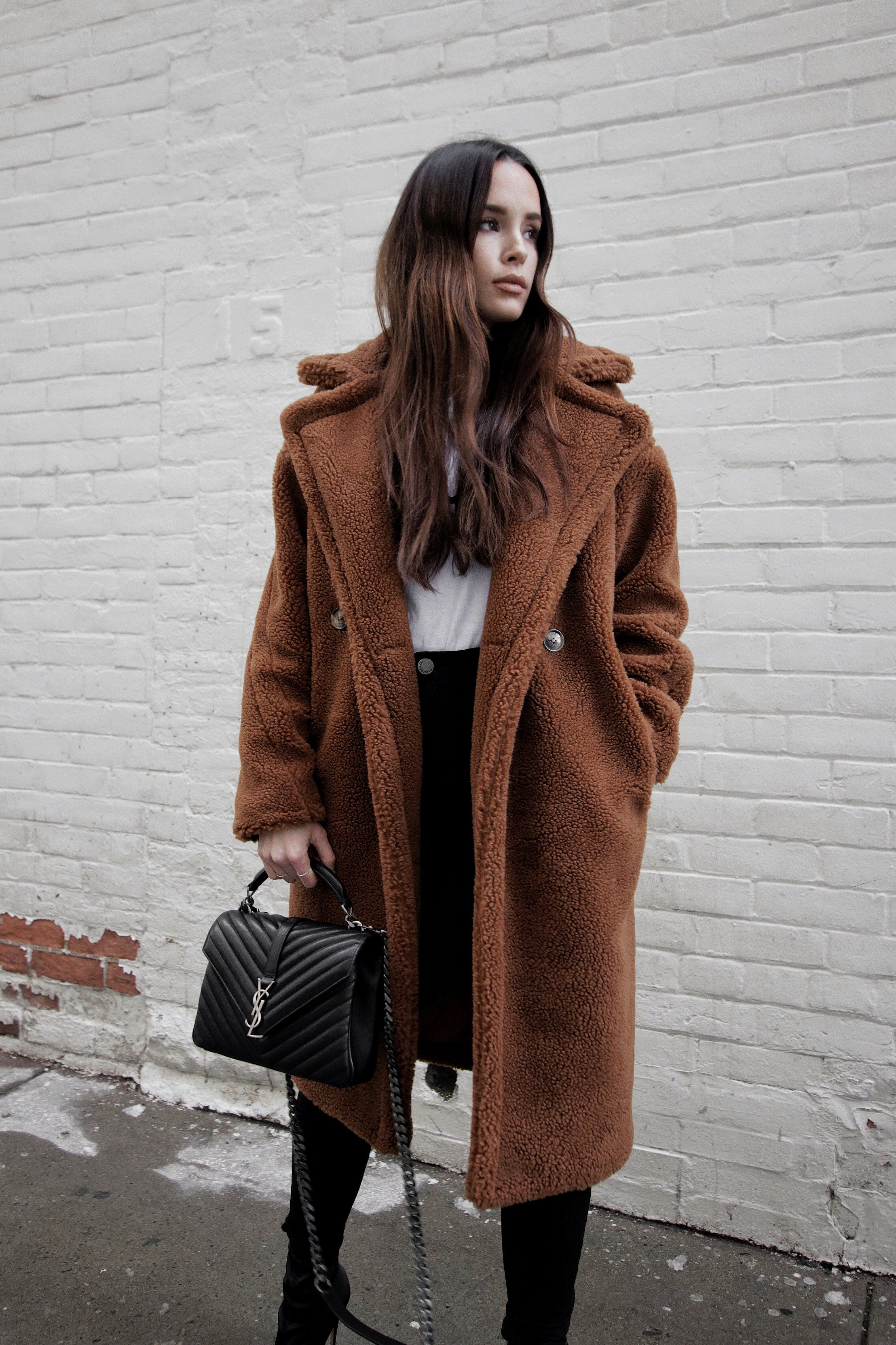 Winter Style   Dark brown teddy coat, black denim, YSL bag