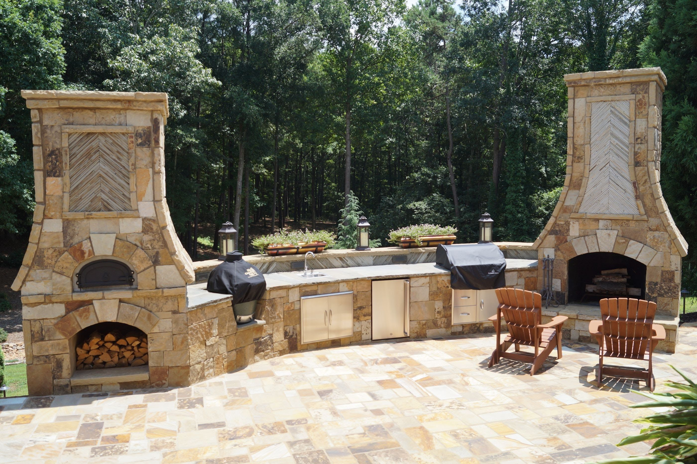 Outdoor kitchen with pizza oven and smoker outdoor decor