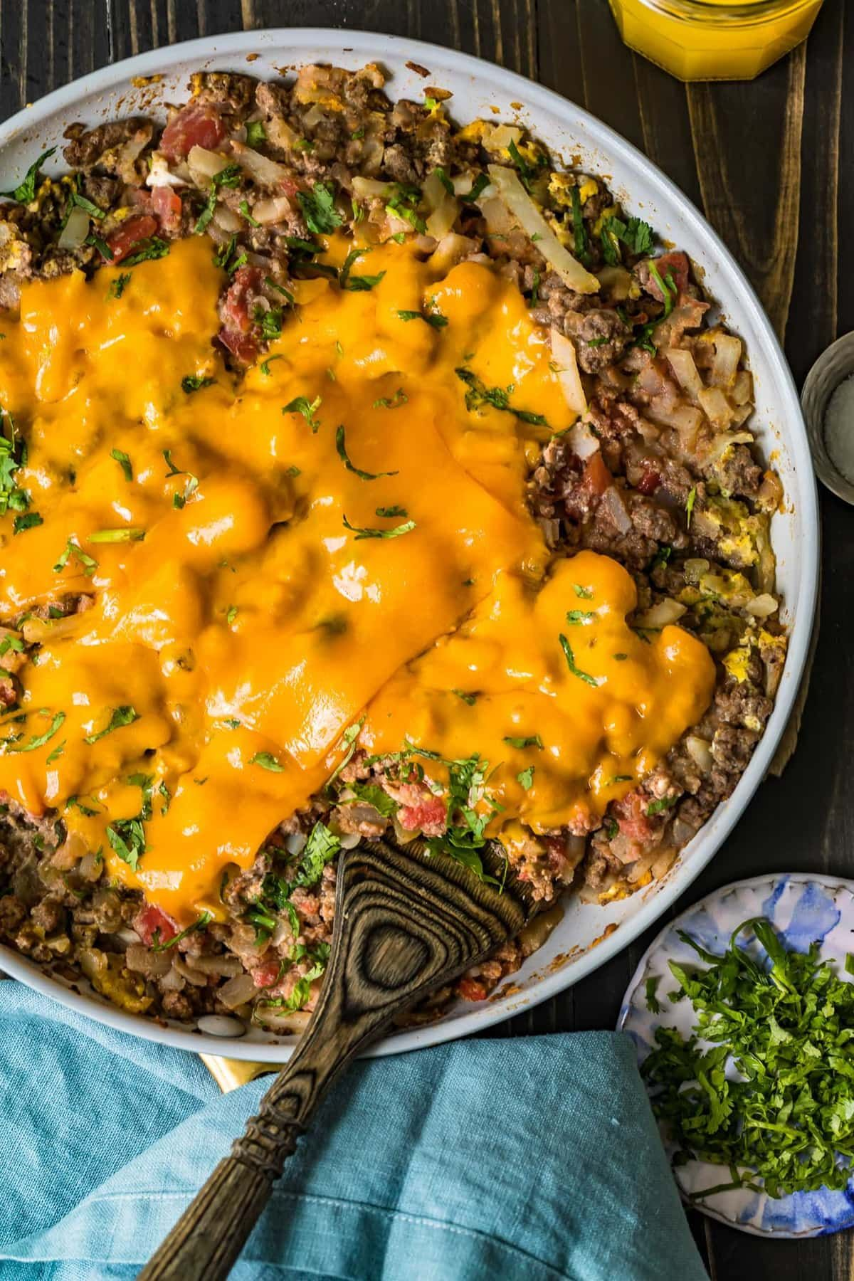 Beef Breakfast Scramble Served In A White Bowl In 2020 Beef Recipes Ground Beef Breakfast Breakfast Skillet