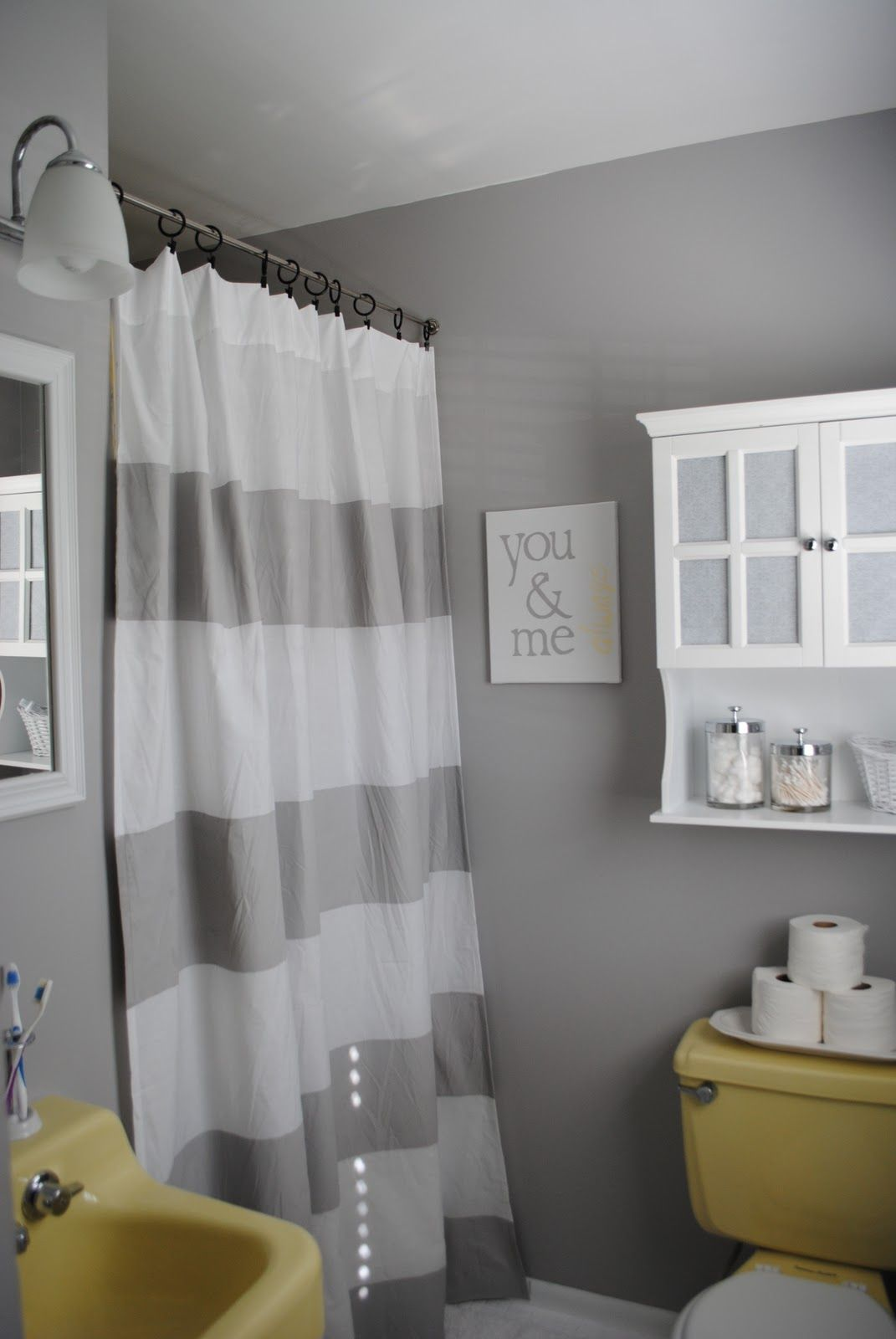 Budget Bathroom Makeover Embracing The 60s Yellow Gray Bathroom Decor Bathroom Makeover Grey Bathrooms