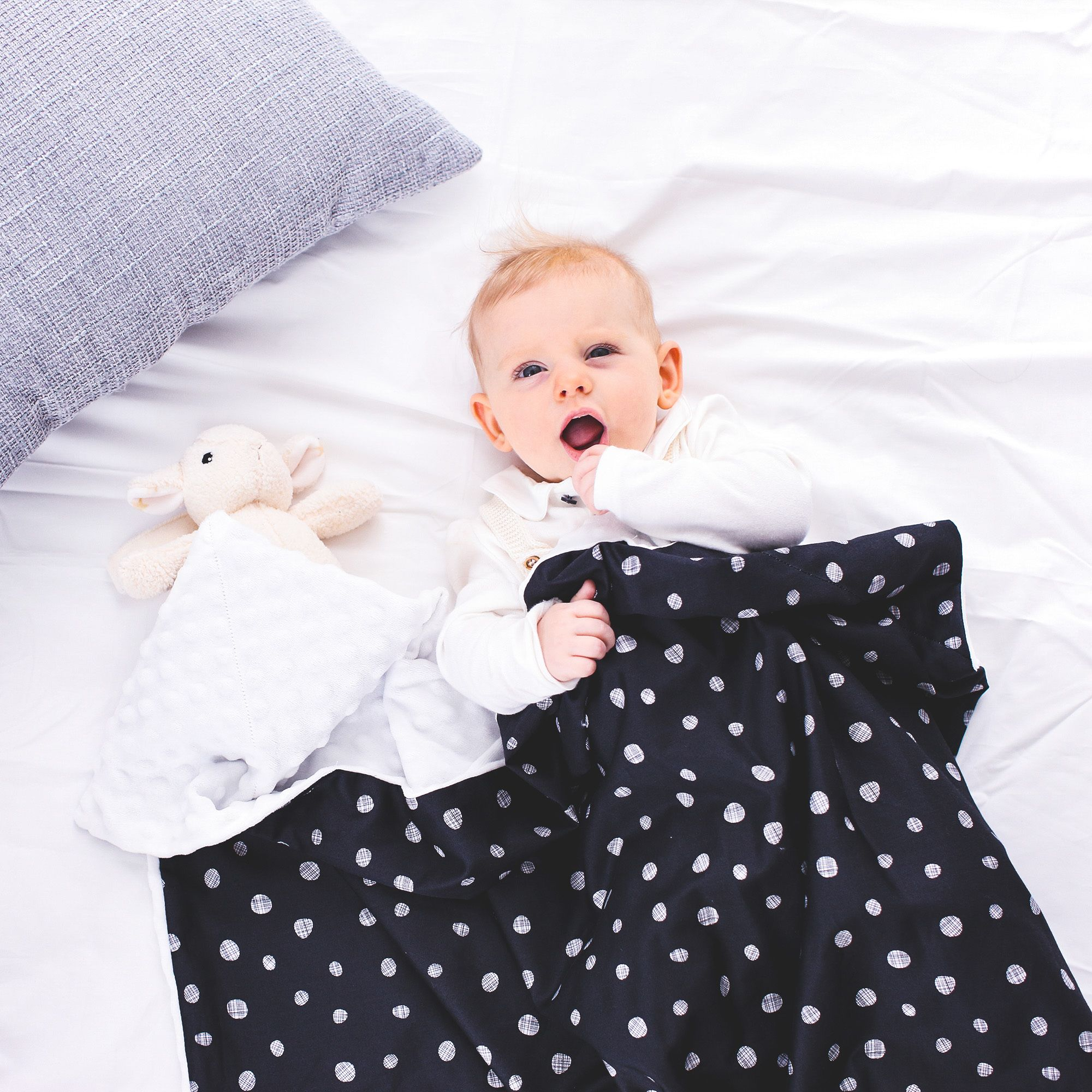 this is sensationally soft, ideal for sensitive skin. The textured dots are fun and soothing for babies and toddlers to touch and feel. The other side of this reversible kids throw is smooth like satin, making it great for tummy time and other nursery floor activities.       #jolimolibrands #donoanddono #babyg #cutebaby #babymusthaves #newbornessentials  #babygoods #simplychildren #newborn #organic #muslin #shopsmall #babyshower #babyboy #nursery #babyblanket #swaddling #babyessentials