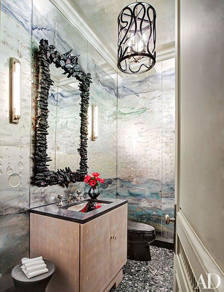 an eve kaplan mirror is set against glass panels by nancy lorenz in the powder room - Glass Sheet Bathroom 2015