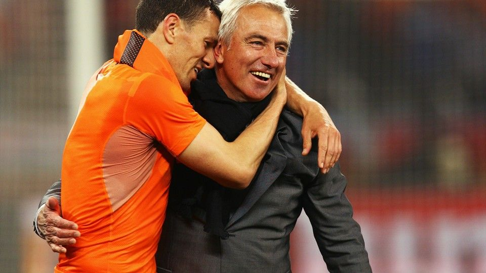 CAPE TOWN, SOUTH AFRICA - JULY 06: Bert van Marwijk head coach of the Netherlands (R) celebrates with Khalid Boulahrouz after the 2010 FIFA World Cup South Africa Semi Final match between Uruguay and the Netherlands at Green Point Stadium on July 6, 2010 in Cape Town, South Africa. (Photo by Quinn Rooney - FIFA/FIFA via Getty Images)