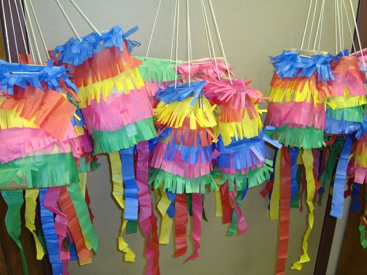 Paper bag Pinatas - made with brown paper lunch bags and colored tissue paper - easy and fun for kids, make cute decorations! Last day craft for Mexico since we are having the fair no last day, we will just make so open end can later be tied at home. This will let kids put prizes in bag during fair
