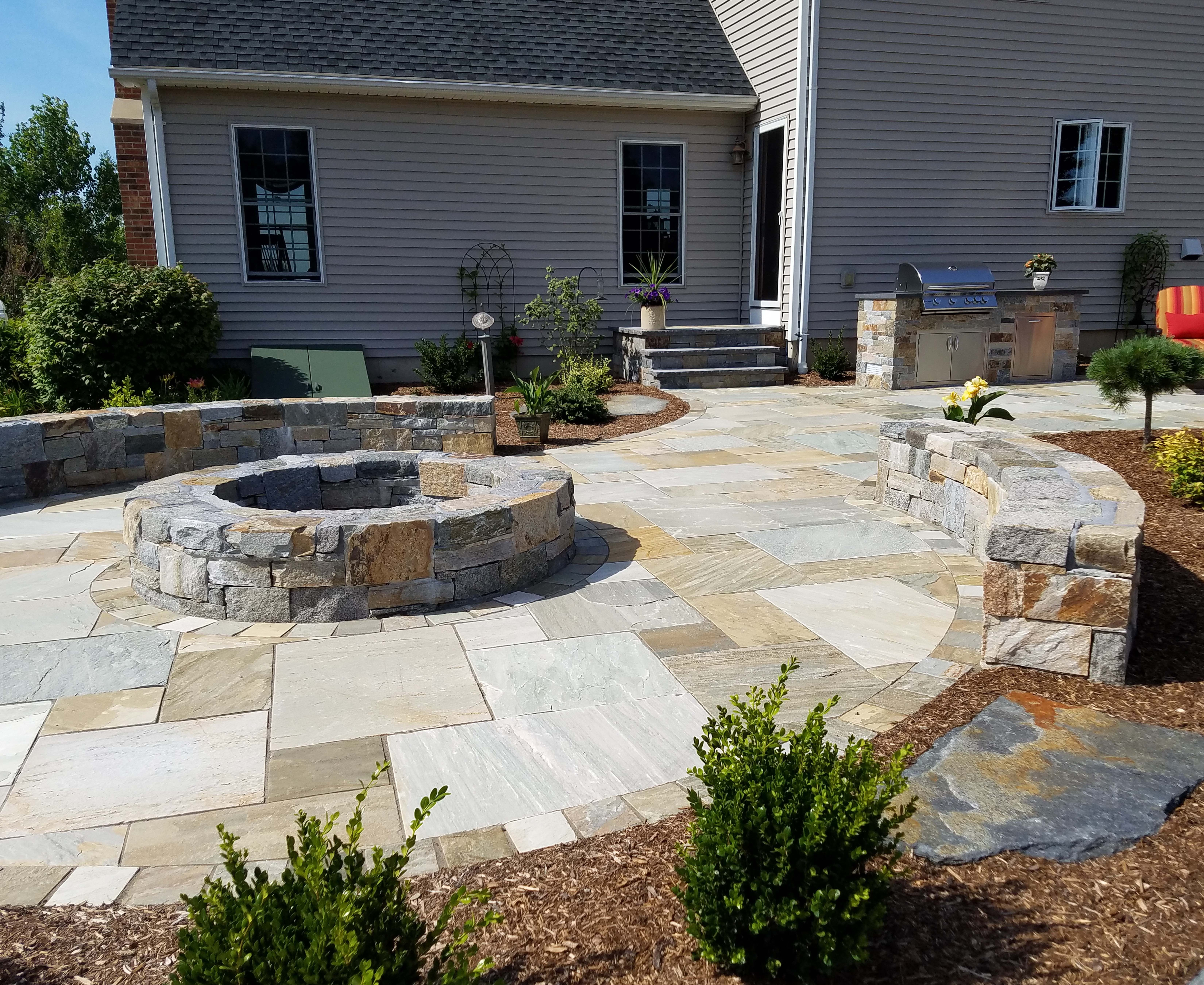 A Natural Stone Fire Pit, Sitting Walls, And Patio Built By Bahler Brothers  In