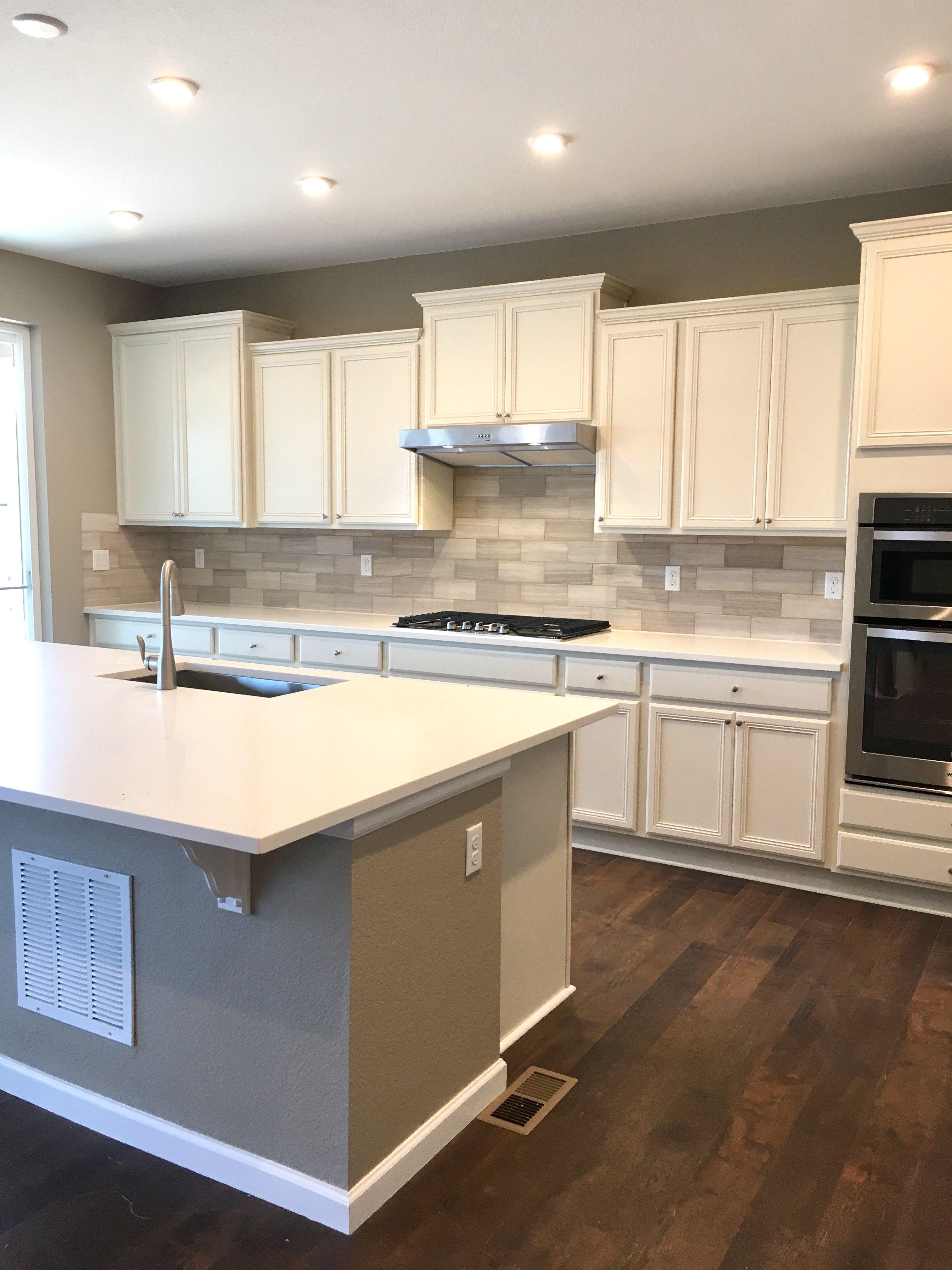 Merillat Glen Arbor Cotton Cabinets Laminate Floors White Quartz Countertops E Kitchen Cabinet Inspiration Laminate Flooring In Kitchen Kitchen Inspirations
