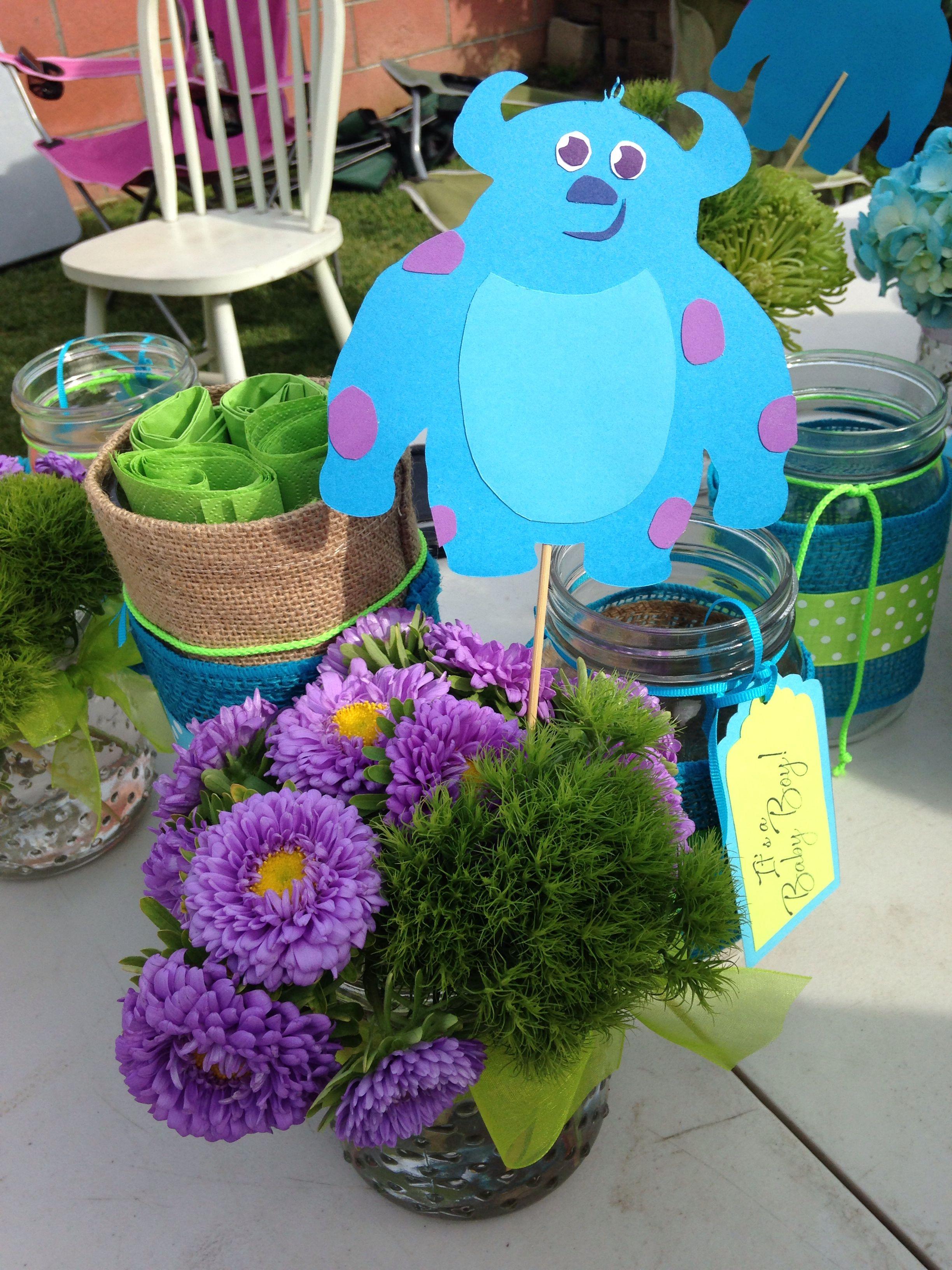 Monsters Inc baby shower centerpieces Wild flowers mason jars