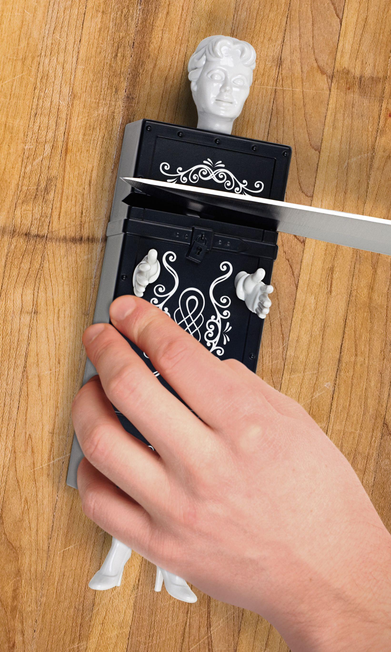 """Knife sharpener that resembles the """"sawing a person in half"""" magic trick keeps the blade of your knife sharp using finely honed carbon steel"""