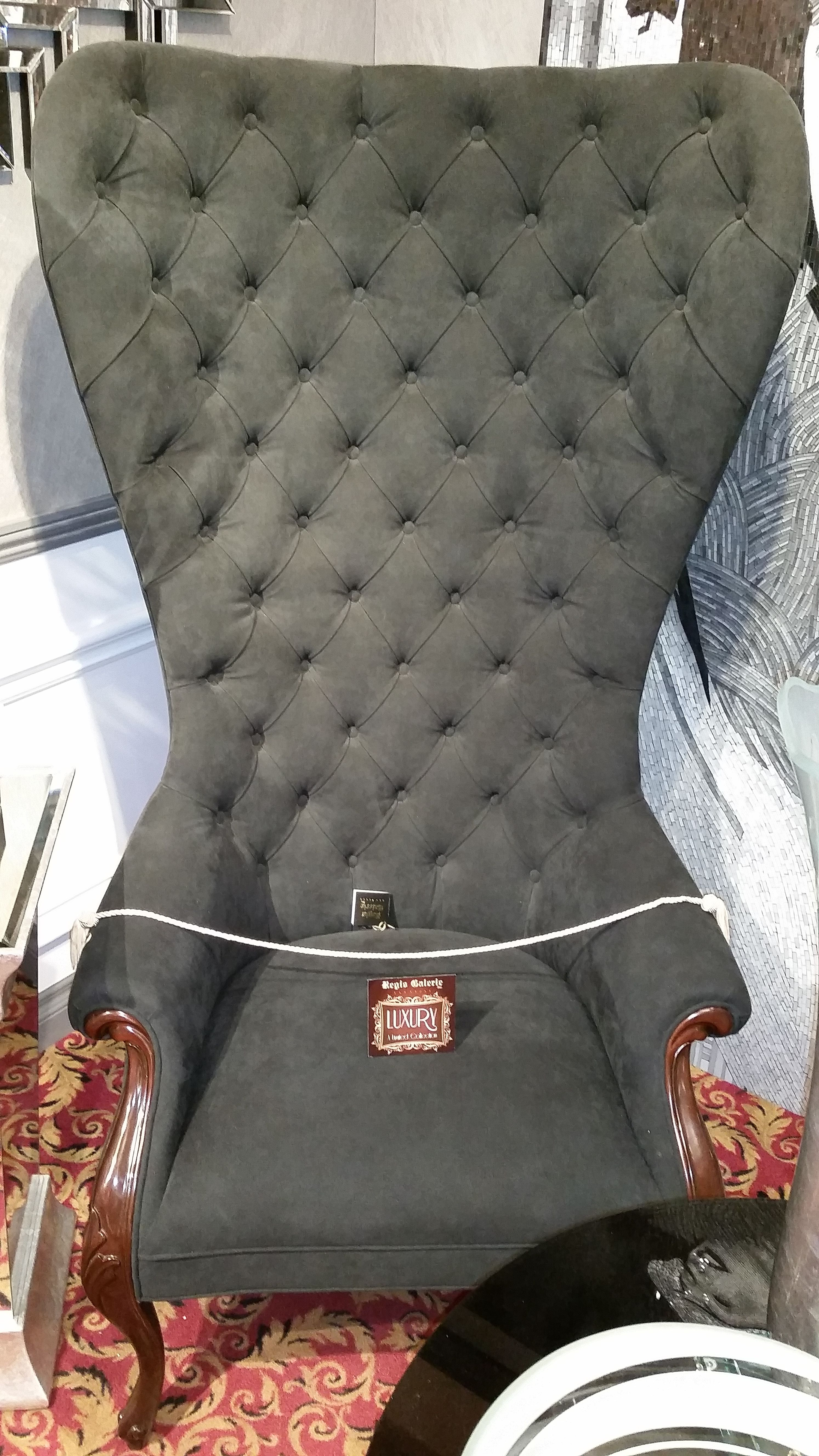 Black tufted high-back chair