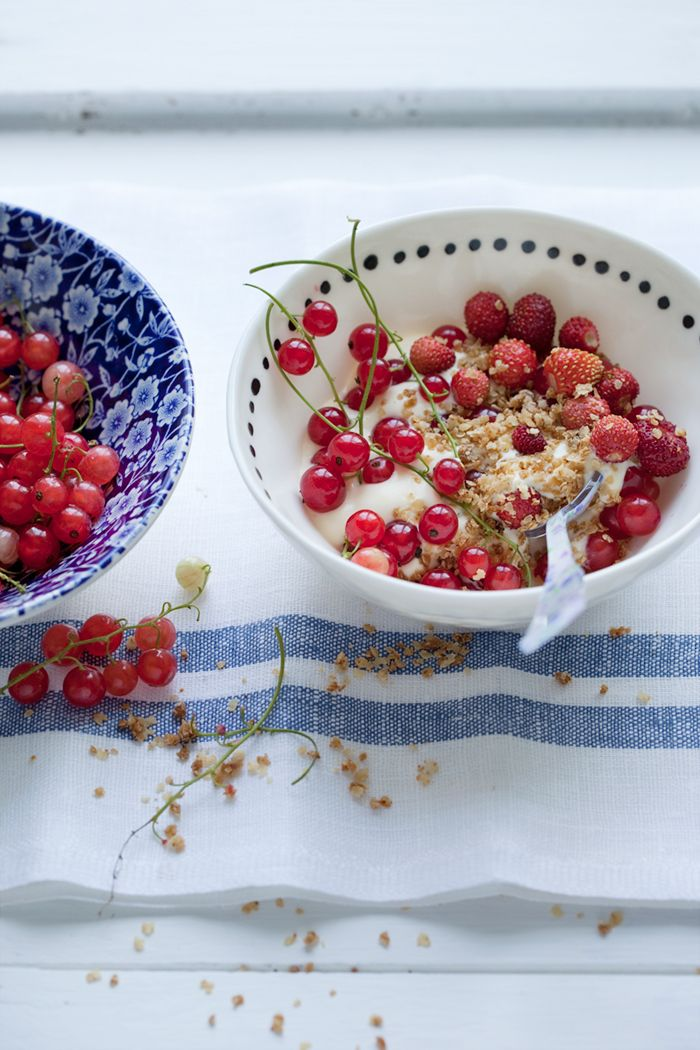 Red berries with custard and pan-toasted millet