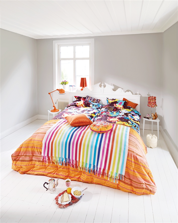colourful sheets and awesome headboard