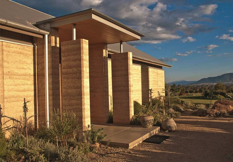 Rammed earth homes construction of walls houses more for Earthen home designs