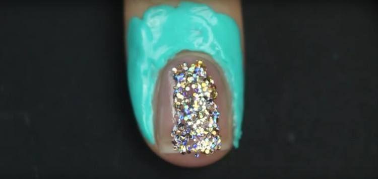 Glitter polish on nail.