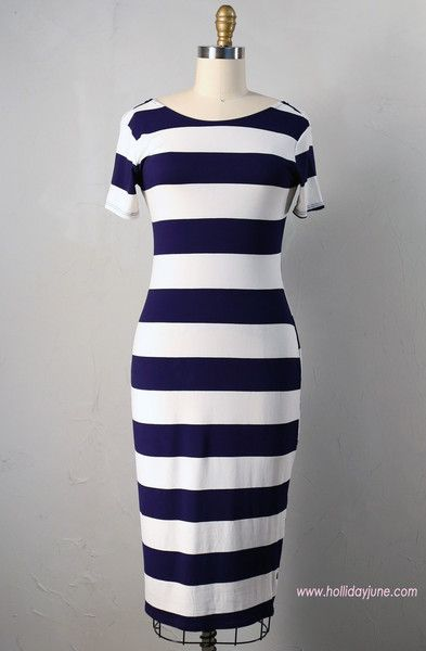 White and navy blue striped below-the-knee dress in a thin lightweight jersey knit fabric. Figure hugging fit. Low scoop neck back.  Great piece for layering! L
