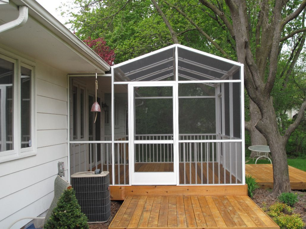 White Screen Porch Enclosure On Deck With Gable Roofline And