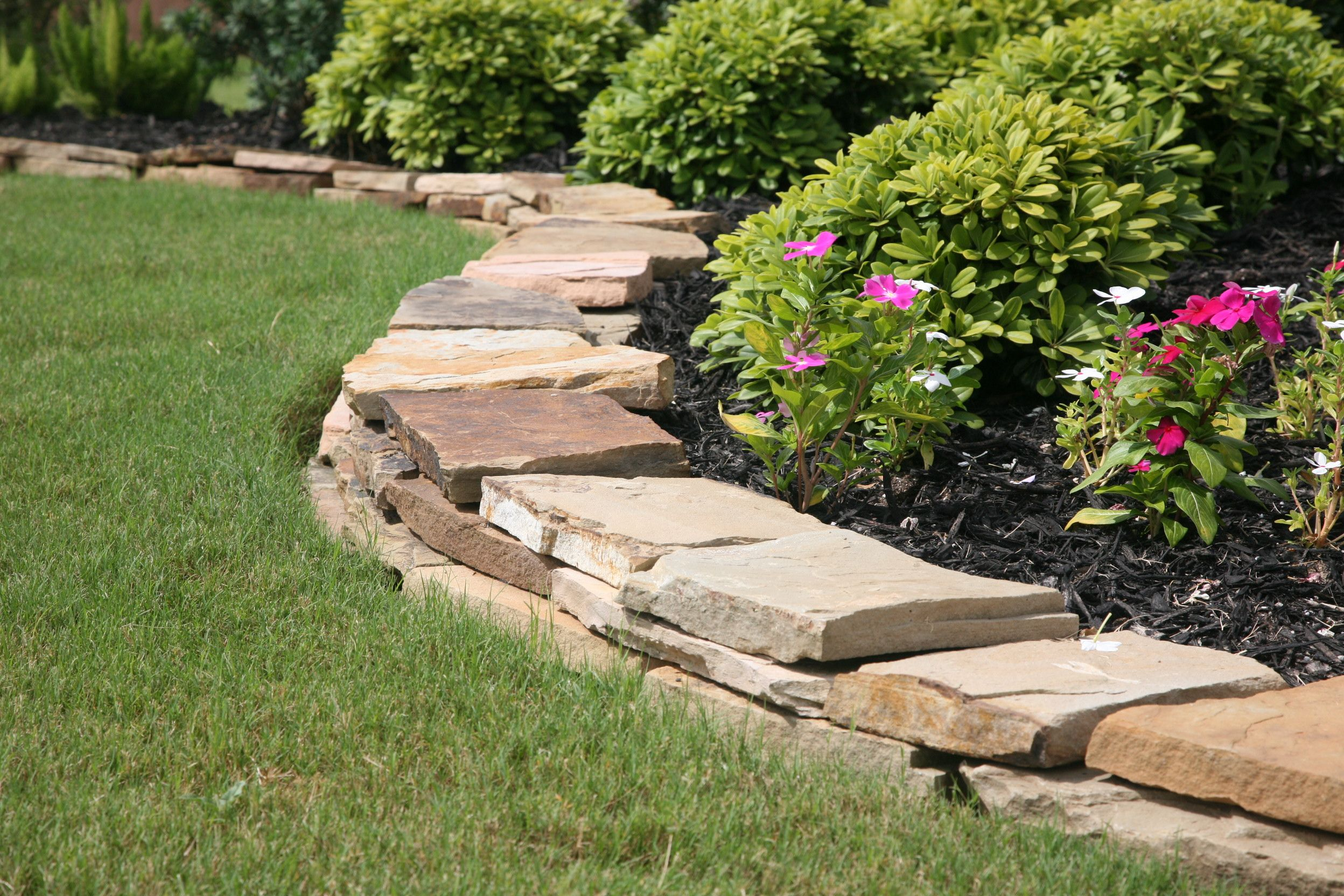 Stacked Flagstone Borders Offer Such A Lovely Mix Of Color Landscaping With Rocks Rock Garden Landscaping Landscape Borders