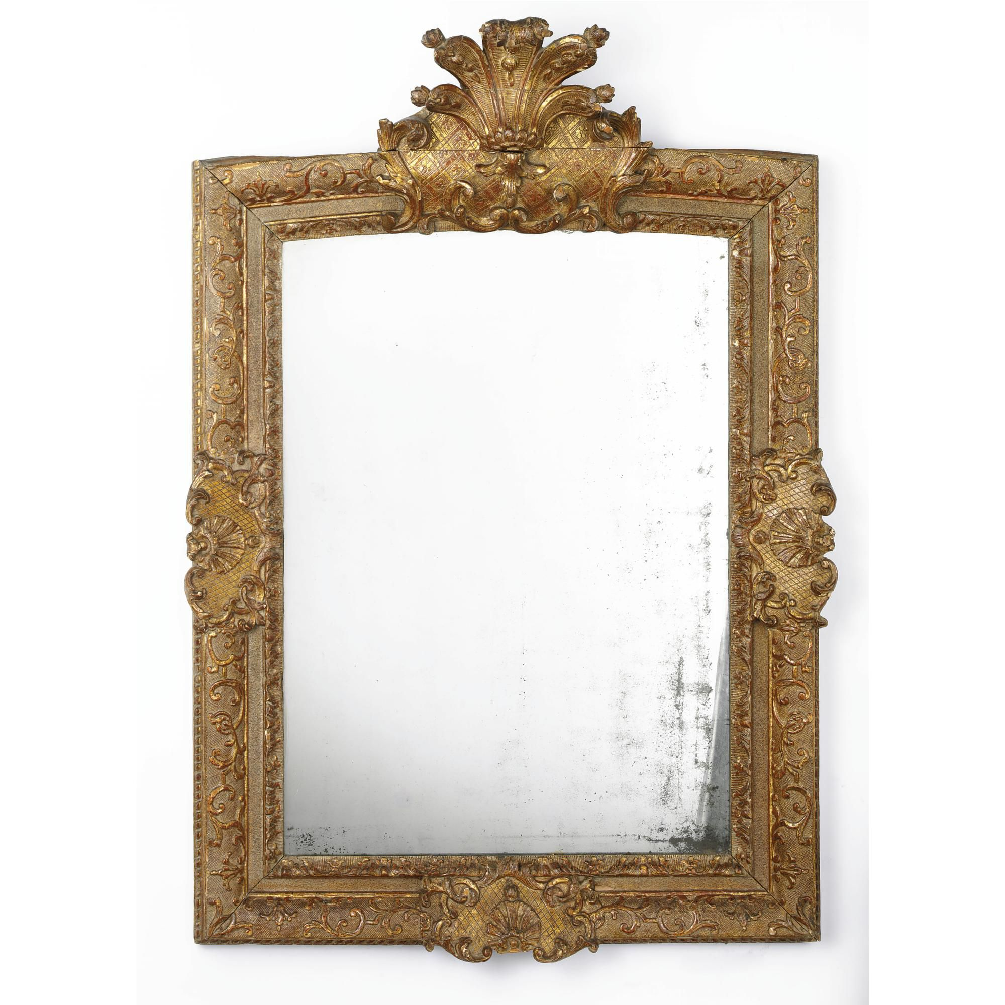 A Régence giltwood mirror first quarter 18th century the rectangular ...