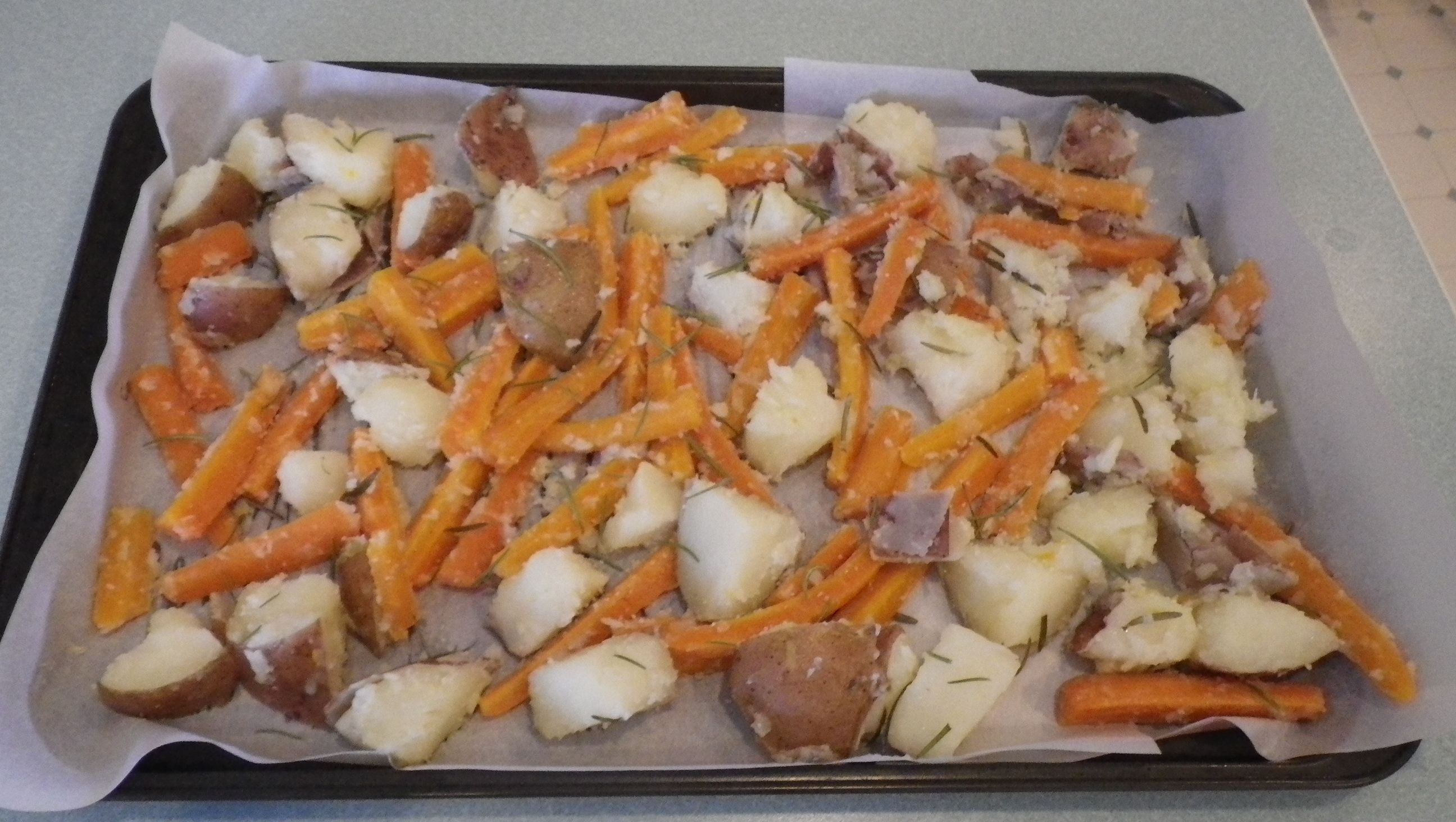 Roast Carrots & Potatoes Part 2 Drain the water from the pot. In a large bowl mash up the cooked garlic cloves and orange (rind removed). Add 2-3 tbs of butter or olive oil or any other fat to the bowl and toss the carrots and potatoes till coated. Then spread out on a lined tray and sprinkle with salt. Roast in a 400F oven 40 minutes.