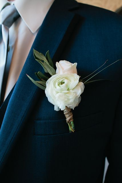 Flowers By Lace And Lilies White Ranunculus And Blush Spray Rose Boutonniere With Eucalyptus Ranunculus Boutonniere White Boutonniere Spray Roses Boutonniere