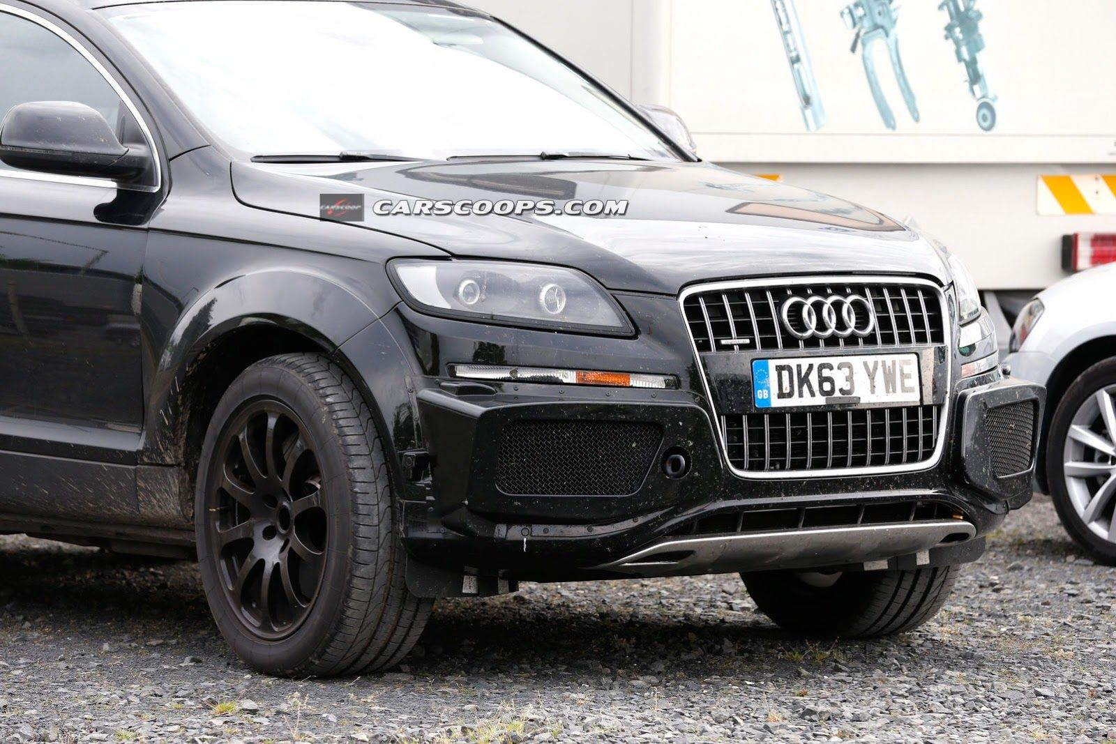 Bentleys upcoming suv spied disguised as a w12 poweredaudi q7