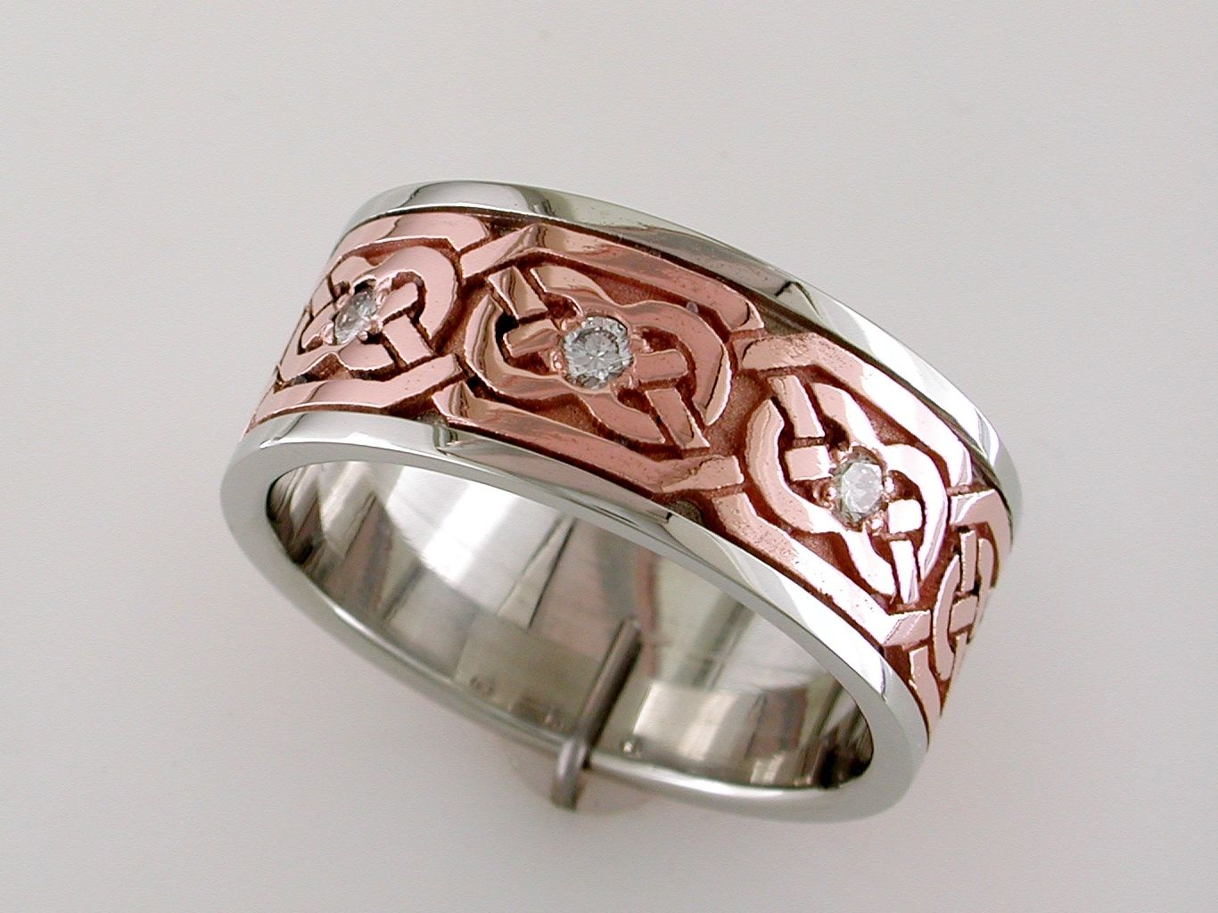 Celtic gents wedding ring made of 14k rose white gold