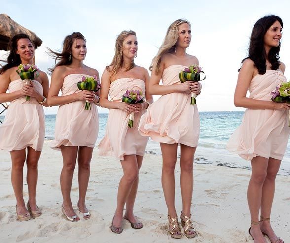ed15d606de Jenny's bridesmaids wore light pink strapless dresses and carried bouquets  of green and purple orchids.