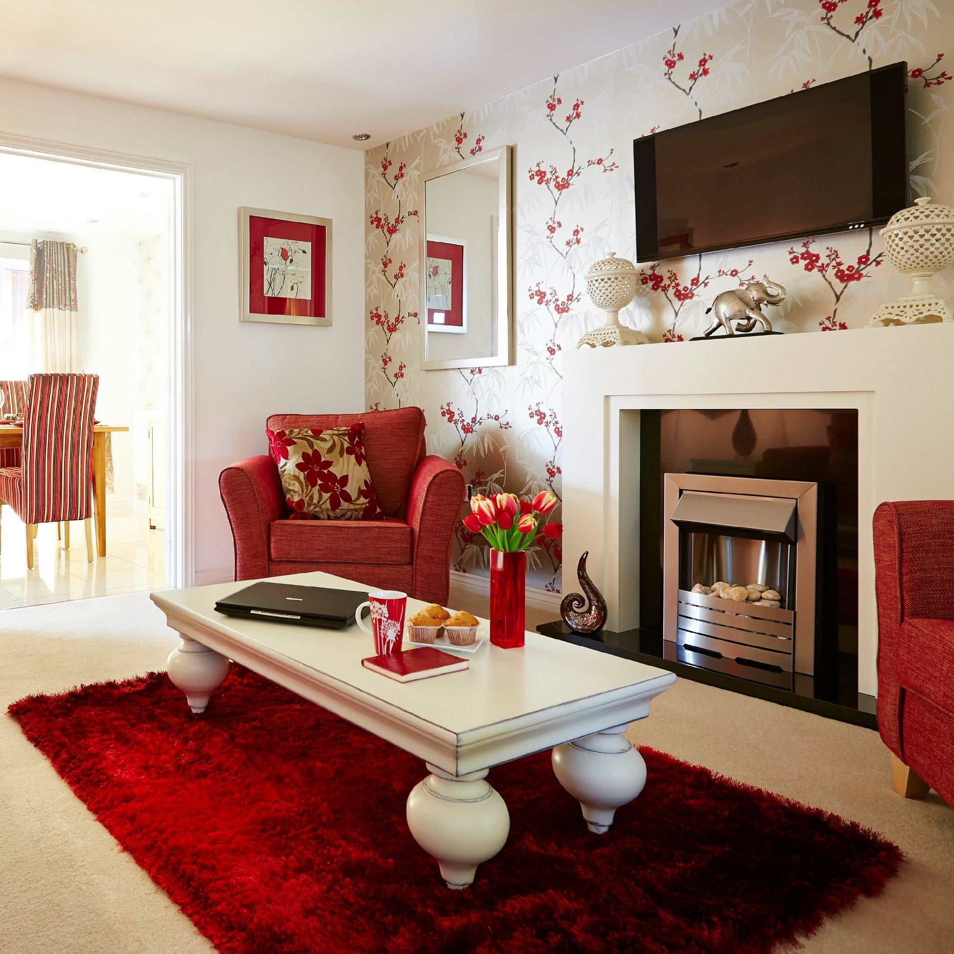 A Plush Red Rug And Ornate Coffee Table, Together With A