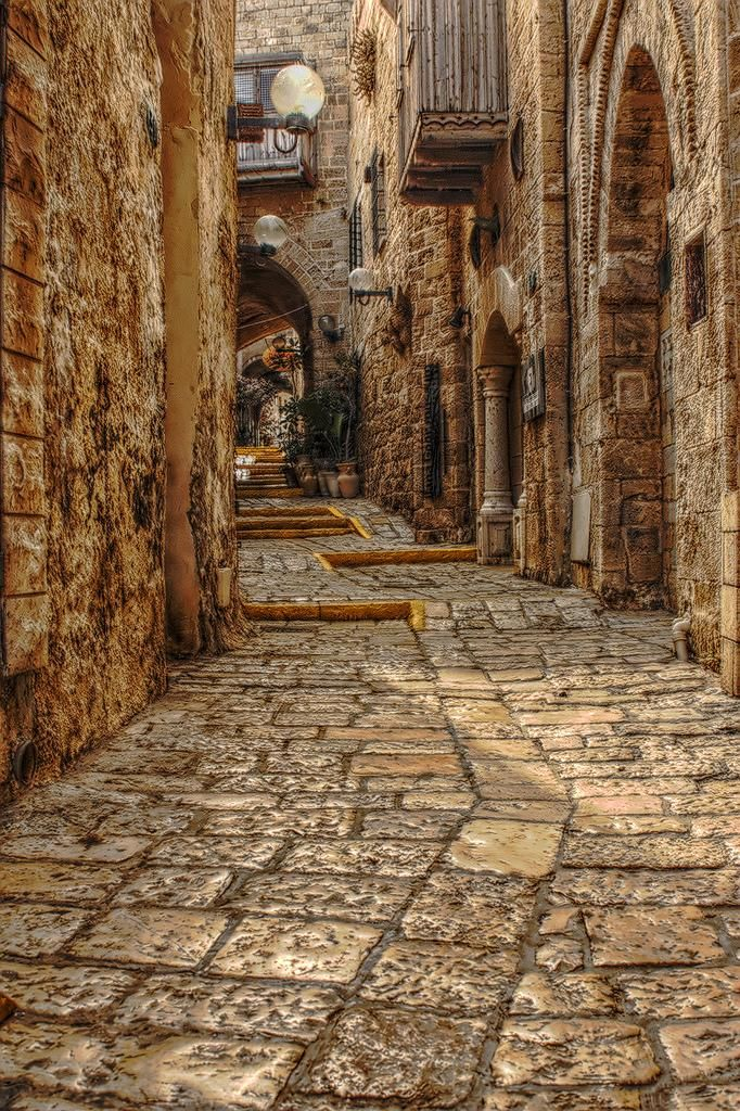 Old Jaffa, Israel.   Over the years, Old Jaffa has been a fitting starting off point for our tours as we arrive at Ben Gurion Airport and stay close by in Tel Aviv our first night.  So surreal to walk these stones under the starts and streetlights and imagine you have traveled back in time.