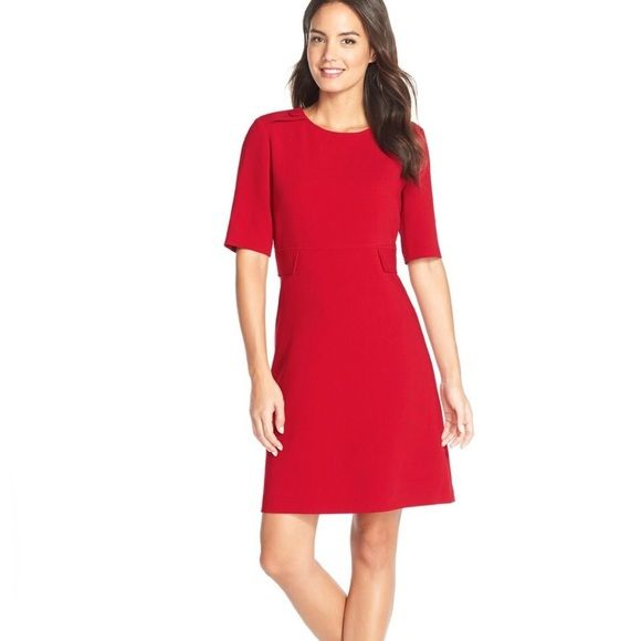 """Red Button Detail A Line Dress Classic red dress with button detail on shoulders, and beautiful silhouette. There are two faded black marks on one shoulder, which could be covered by long hair. Bust is 40"""", waist is 35"""", hips are 44"""", and length is 35"""". Tahari Dresses Midi"""