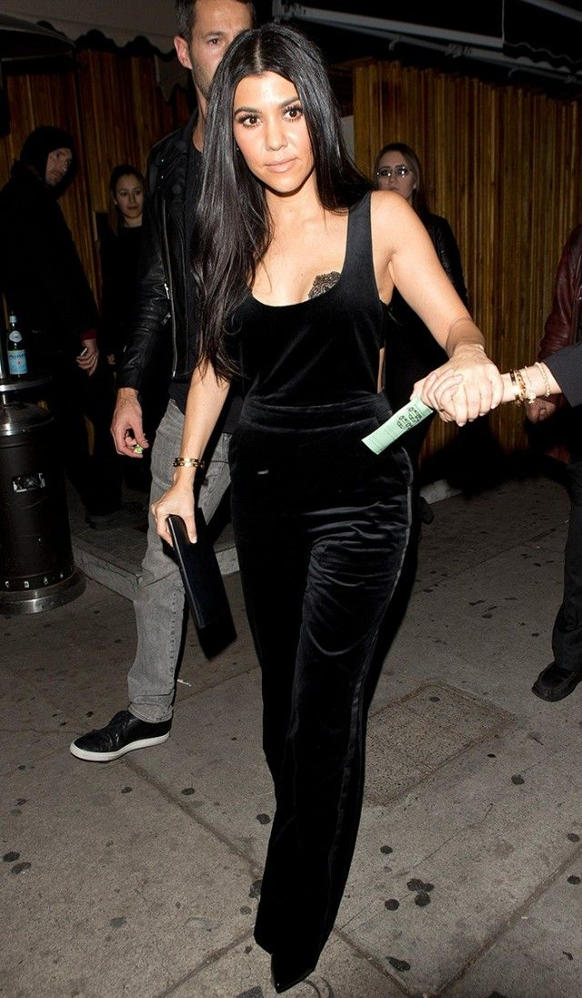 12a91c5953b Kourtney Kardashian wears a lace bra with a velvet jumpsuit and black clutch