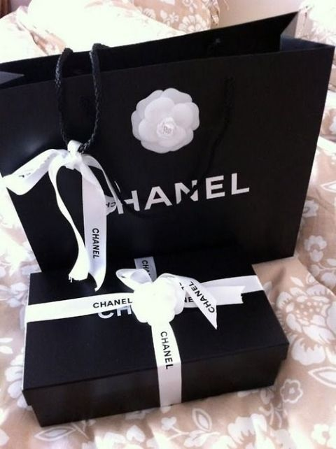 55f52b49992f Every Chanel shopping bag is decorated with a white Camellia, which was  Coco Chanel's favorite flower. Die hard Chaneliacs collect these too.